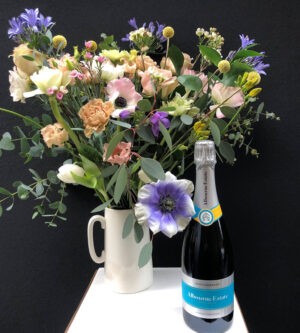 Bunch of flowers next to bottle of Albourne Estate Sparkling Wine - MultiVintage